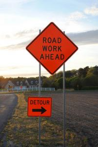 sign marked roadwork ahead and indicating detour