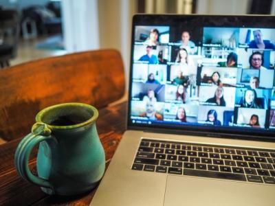 Mug by laptop with a Zoom call