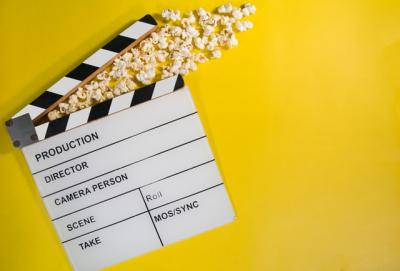 Clapperboard and popcorn