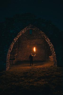 Man holding torch in the dark