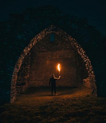 Man holding flare in the dark