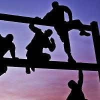 People climbing over bars