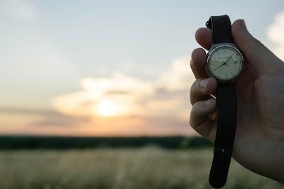 Hand holding watch